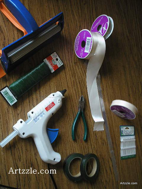 I assembled tools to begin making bouts. * Two widths of satin ribbon in two colors * Tin snips * Wire (this is 26 gauge, suitable for small projects and beaded strips) * Hot glue gun * Optional Crimper (sometimes it's fun to crimp some of your ribbon) * Pearl tipped strait pins